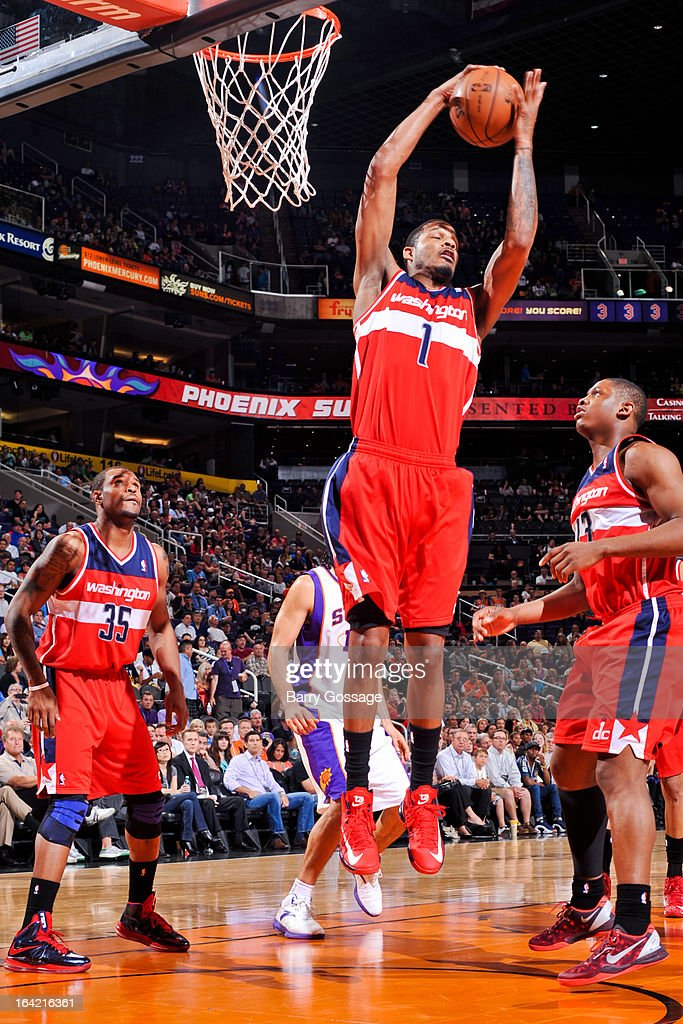 <a gi-track='captionPersonalityLinkClicked' href=/galleries/search?phrase=Trevor+Ariza&family=editorial&specificpeople=201708 ng-click='$event.stopPropagation()'>Trevor Ariza</a> #1 of the Washington Wizards grabs a rebound against the Phoenix Suns on March 20, 2013 at U.S. Airways Center in Phoenix, Arizona.