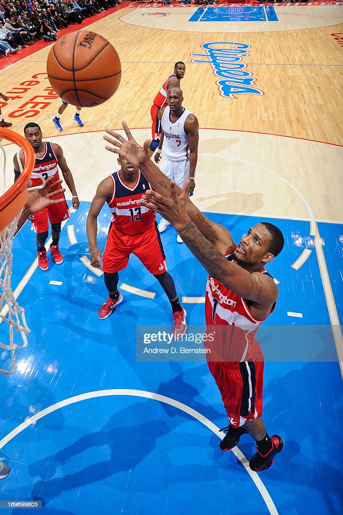 <a gi-track='captionPersonalityLinkClicked' href=/galleries/search?phrase=Trevor+Ariza&family=editorial&specificpeople=201708 ng-click='$event.stopPropagation()'>Trevor Ariza</a> #1 of the Washington Wizards grabs a rebound against the Los Angeles Clippers at Staples Center on January 19, 2013 in Los Angeles, California.