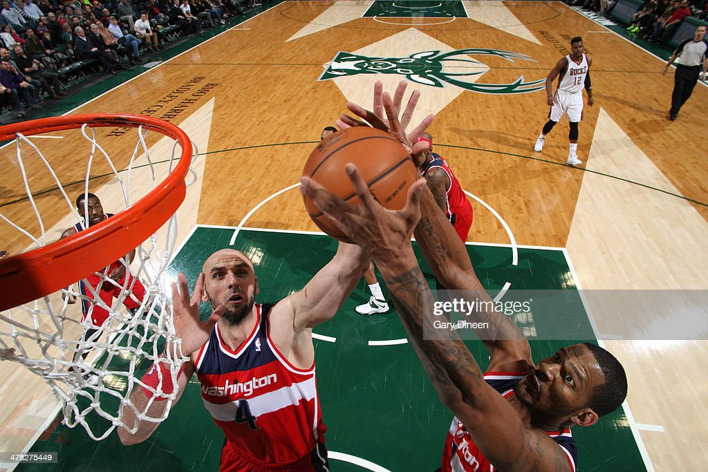 <a gi-track='captionPersonalityLinkClicked' href=/galleries/search?phrase=Trevor+Ariza&family=editorial&specificpeople=201708 ng-click='$event.stopPropagation()'>Trevor Ariza</a> #1 of the Washington Wizards grabs a rebound against the Milwaukee Bucks on March 8, 2014 at the BMO Harris Bradley Center in Milwaukee, Wisconsin.