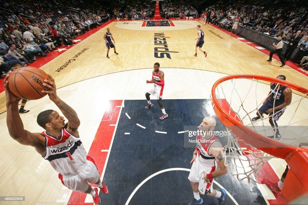 <a gi-track='captionPersonalityLinkClicked' href=/galleries/search?phrase=Trevor+Ariza&family=editorial&specificpeople=201708 ng-click='$event.stopPropagation()'>Trevor Ariza</a> #1 of the Washington Wizards grabs a rebound against the Charlotte Bobcats at the Verizon Center on April 9, 2014 in Washington, DC.