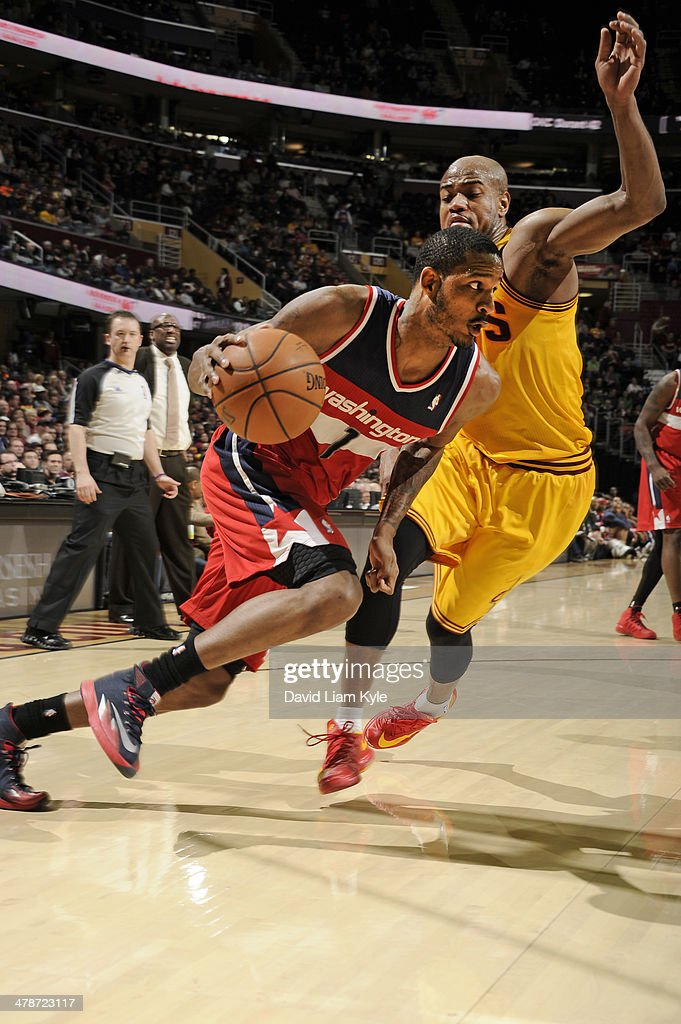 <a gi-track='captionPersonalityLinkClicked' href=/galleries/search?phrase=Trevor+Ariza&family=editorial&specificpeople=201708 ng-click='$event.stopPropagation()'>Trevor Ariza</a> #1 of the Washington Wizards handles the ball against the Cleveland Cavaliers at The Quicken Loans Arena on February 23, 2014 in Cleveland, Ohio.