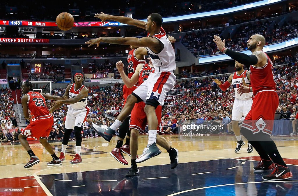 <a gi-track='captionPersonalityLinkClicked' href=/galleries/search?phrase=Trevor+Ariza&family=editorial&specificpeople=201708 ng-click='$event.stopPropagation()'>Trevor Ariza</a> #1 of the Washington Wizards pases the ball in the lane over <a gi-track='captionPersonalityLinkClicked' href=/galleries/search?phrase=Mike+Dunleavy&family=editorial&specificpeople=201802 ng-click='$event.stopPropagation()'>Mike Dunleavy</a> #34 of the Chicago Bulls in Game Four of the Eastern Conference Quarterfinals during the 2014 NBA Playoffs at the Verizon Center on April 27, 2014 in Washington, DC.