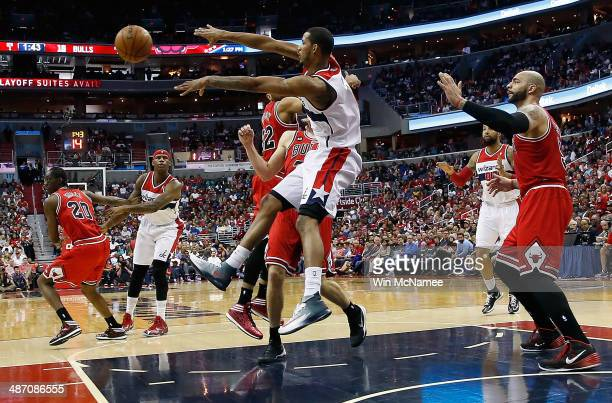Trevor Ariza of the Washington Wizards pases the ball in the lane over Mike Dunleavy of the Chicago Bulls in Game Four of the Eastern Conference...