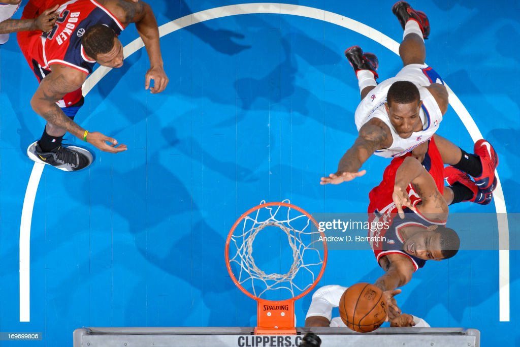 Trevor Ariza #1 of the Washington Wizards shoots a layup against Eric Bledsoe #12 of the Los Angeles Clippers at Staples Center on January 19, 2013 in Los Angeles, California.