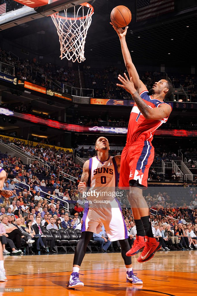 Trevor Ariza #1 of the Washington Wizards shoots a layup against Michael Beasley #0 of the Phoenix Suns on March 20, 2013 at U.S. Airways Center in Phoenix, Arizona.