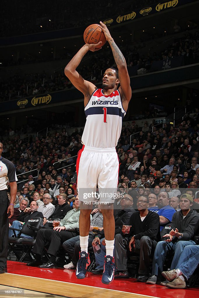 Trevor Ariza #1 of the Washington Wizards shoots a three pointer against the New York Knicks at the Verizon Center on March 1, 2013 in Washington, DC.