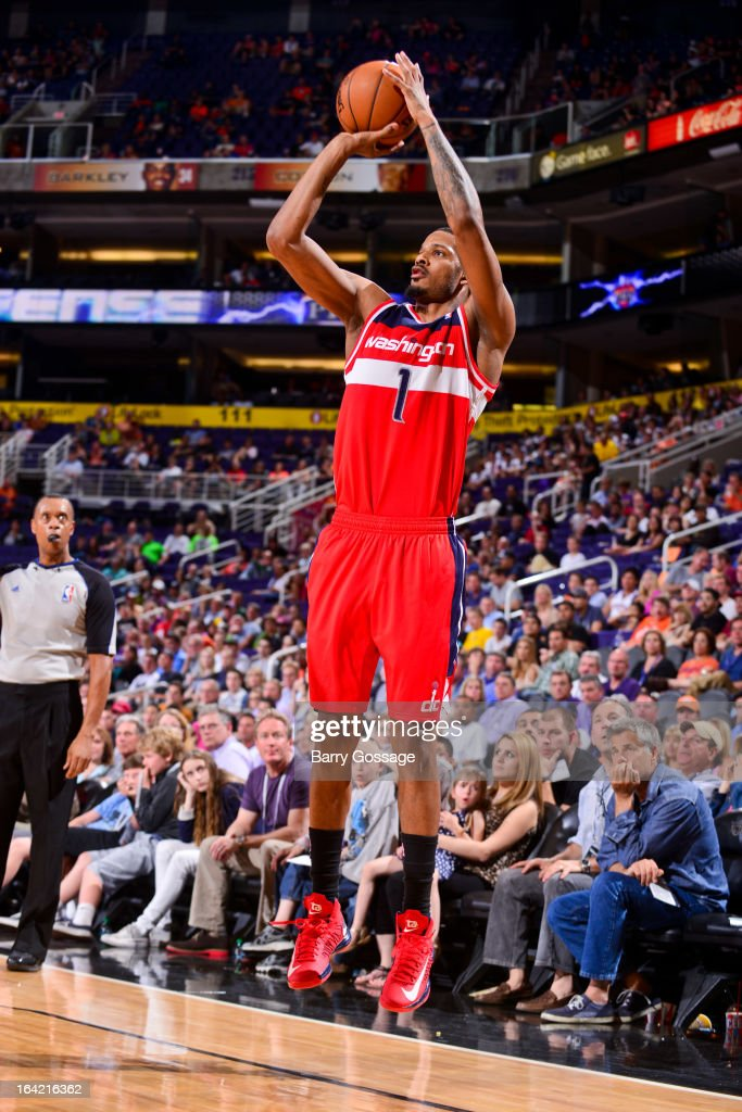 <a gi-track='captionPersonalityLinkClicked' href=/galleries/search?phrase=Trevor+Ariza&family=editorial&specificpeople=201708 ng-click='$event.stopPropagation()'>Trevor Ariza</a> #1 of the Washington Wizards shoots a three-pointer against the Phoenix Suns on March 20, 2013 at U.S. Airways Center in Phoenix, Arizona.
