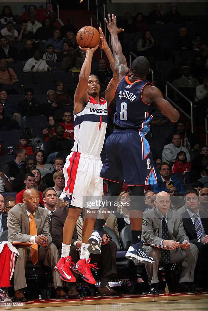 Trevor Ariza #1 of the Washington Wizards shoots against Ben Gordon #8 of the Charlotte Bobcats during the game at the Verizon Center on March 9, 2013 in Washington, DC.