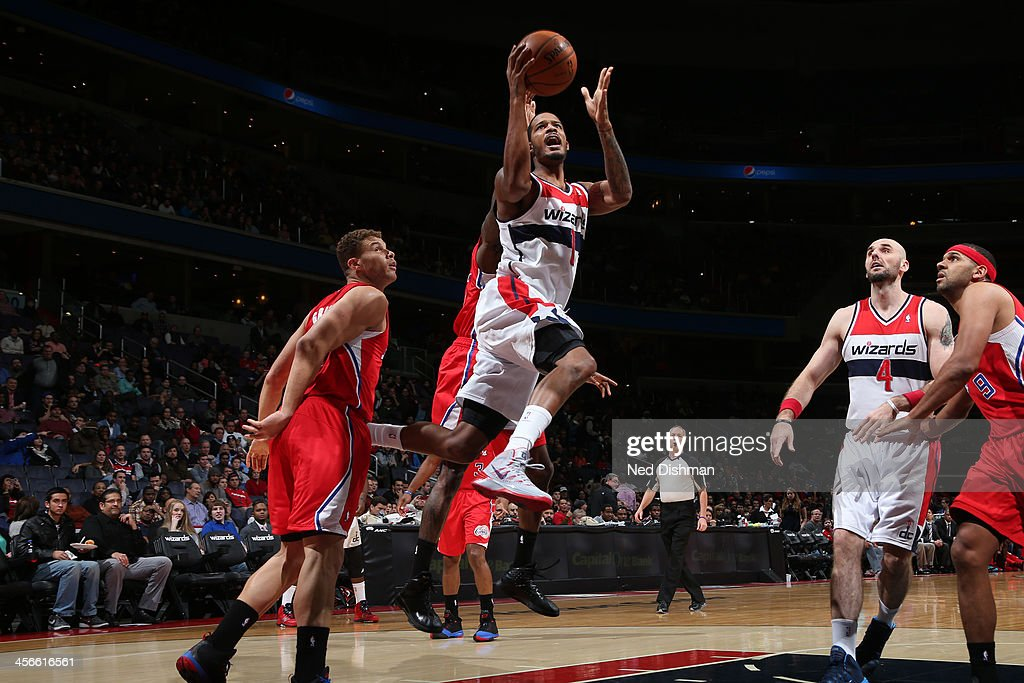 <a gi-track='captionPersonalityLinkClicked' href=/galleries/search?phrase=Trevor+Ariza&family=editorial&specificpeople=201708 ng-click='$event.stopPropagation()'>Trevor Ariza</a> #1 of the Washington Wizards shoots against Blake Griffin #32 of the Los Angeles Clippers during the game at the Verizon Center on December 14, 2013 in Washington, DC.