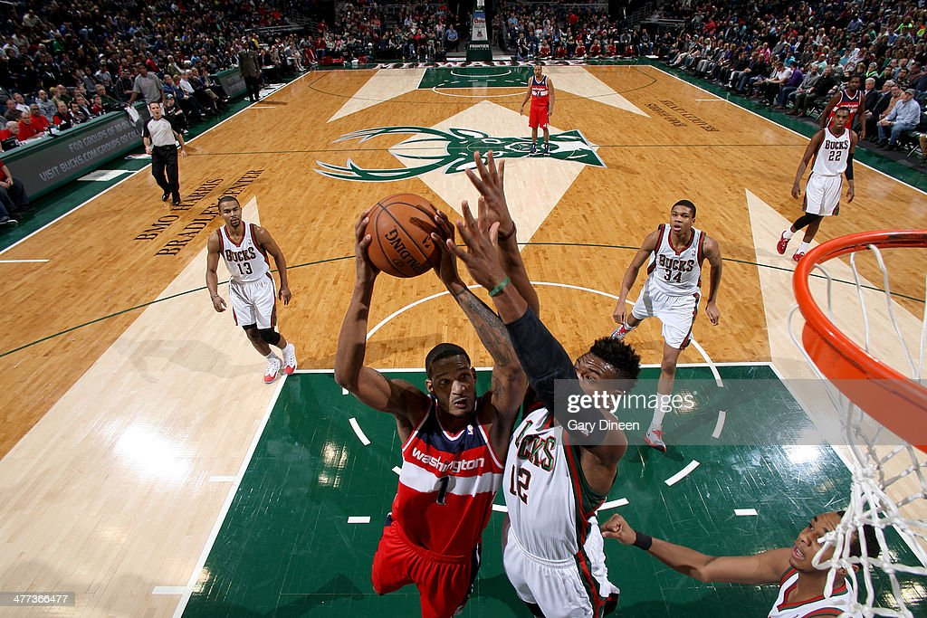 Trevor Ariza #1 of the Washington Wizards shoots against Jeff Adrien #12 of the Milwaukee Bucks on March 8, 2014 at the BMO Harris Bradley Center in Milwaukee, Wisconsin.