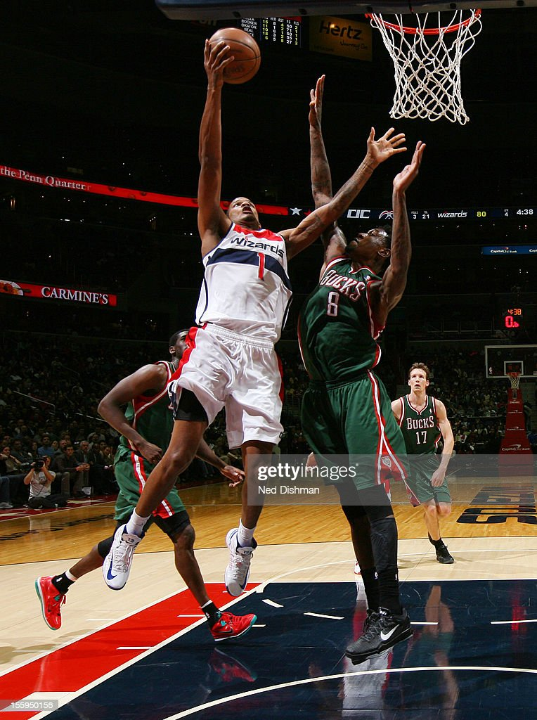 <a gi-track='captionPersonalityLinkClicked' href=/galleries/search?phrase=Trevor+Ariza&family=editorial&specificpeople=201708 ng-click='$event.stopPropagation()'>Trevor Ariza</a> #1 of the Washington Wizards shoots against Larry Sanders #8 of the Milwaukee Bucks during the game at the Verizon Center on November 9, 2012 in Washington, DC.