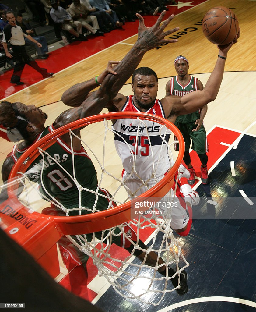 <a gi-track='captionPersonalityLinkClicked' href=/galleries/search?phrase=Trevor+Ariza&family=editorial&specificpeople=201708 ng-click='$event.stopPropagation()'>Trevor Ariza</a> #35 of the Washington Wizards shoots against Larry Sanders #8 of the Milwaukee Bucks during the game at the Verizon Center on November 9, 2012 in Washington, DC.