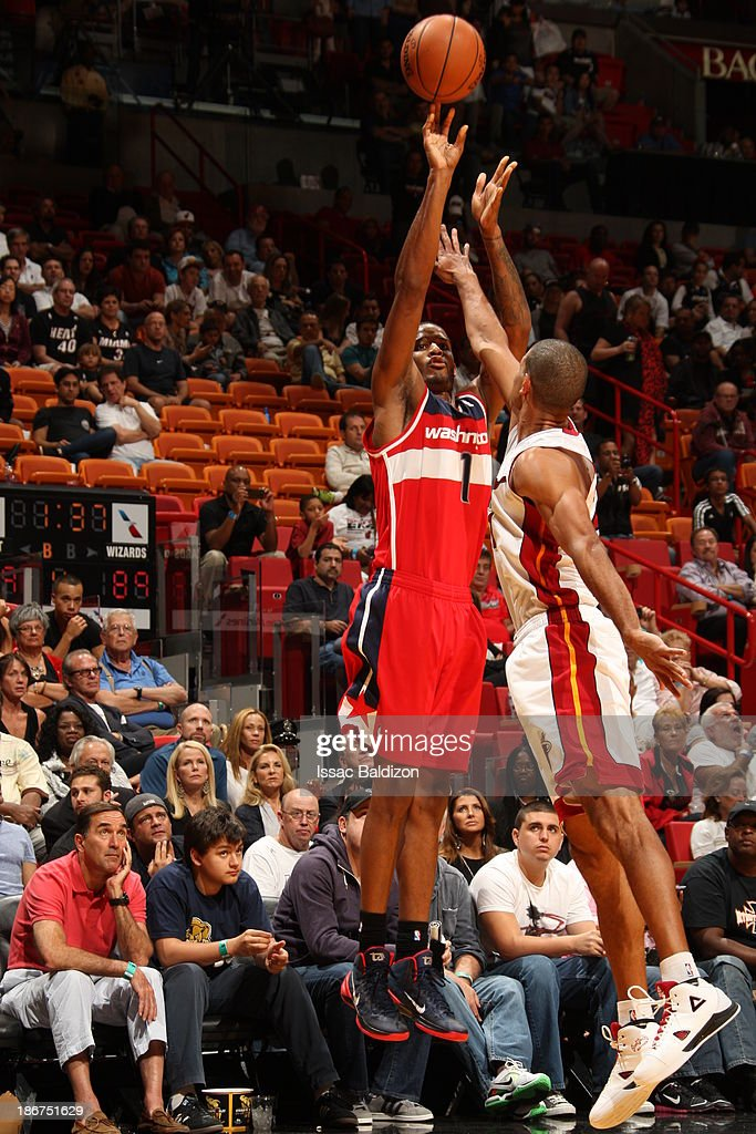 <a gi-track='captionPersonalityLinkClicked' href=/galleries/search?phrase=Trevor+Ariza&family=editorial&specificpeople=201708 ng-click='$event.stopPropagation()'>Trevor Ariza</a> #1 of the Washington Wizards shoots against <a gi-track='captionPersonalityLinkClicked' href=/galleries/search?phrase=Shane+Battier&family=editorial&specificpeople=201814 ng-click='$event.stopPropagation()'>Shane Battier</a> #31 of the Miami Heat n November 3, 2013 at American Airlines Arena in Miami, Florida.