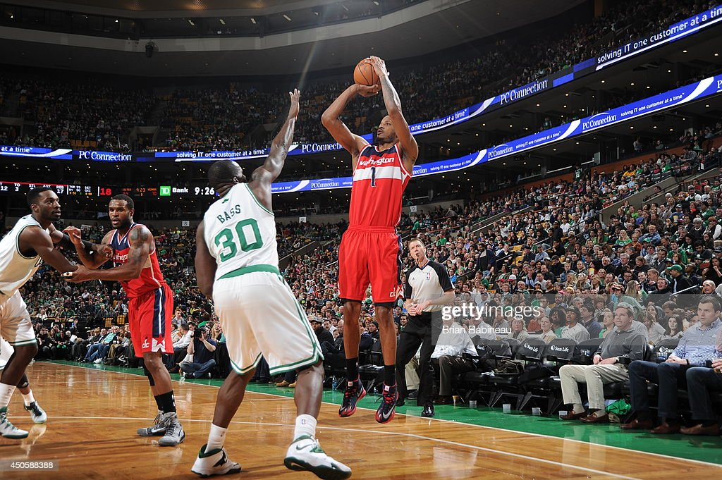 Trevor Ariza #1 of the Washington Wizards shoots against the Boston Celtics on April 16, 2014 at the TD Garden in Boston, Massachusetts.