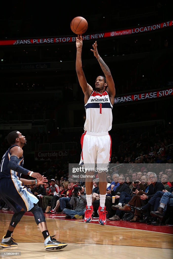 <a gi-track='captionPersonalityLinkClicked' href=/galleries/search?phrase=Trevor+Ariza&family=editorial&specificpeople=201708 ng-click='$event.stopPropagation()'>Trevor Ariza</a> #1 of the Washington Wizards shoots against the Memphis Grizzlies at the Verizon Center on March 3, 2014 in Washington, DC.