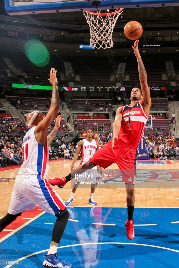 Trevor Ariza #1 of the Washington Wizards shoots in the lane against Charlie Villanueva #31 of the Detroit Pistons on February 13, 2013 at The Palace of Auburn Hills in Auburn Hills, Michigan.