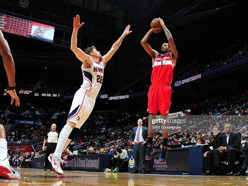 Trevor Ariza #1 of the Washington Wizards shoots the ball against the Atlanta Hawks on December 13, 2013 at Philips Arena in Atlanta, Georgia.