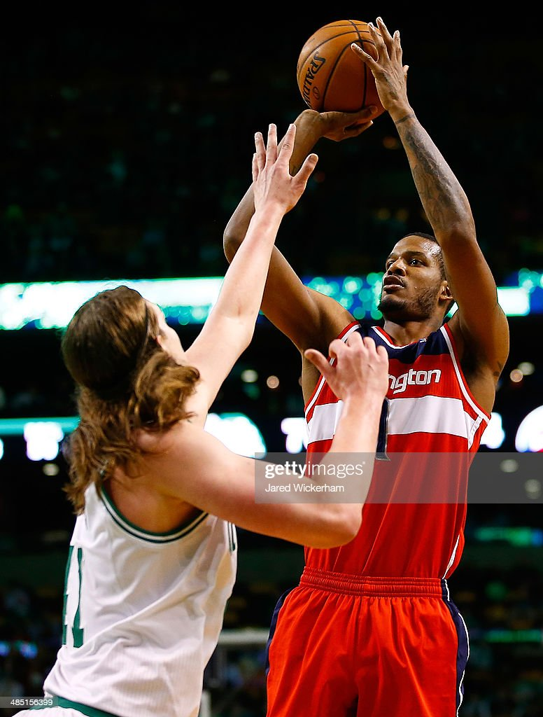 Trevor Ariza #1 of the Washington Wizards takes a shot over Kelly Olynyk #41 of the Boston Celtics in the second half during the game at TD Garden on April 16, 2014 in Boston, Massachusetts.