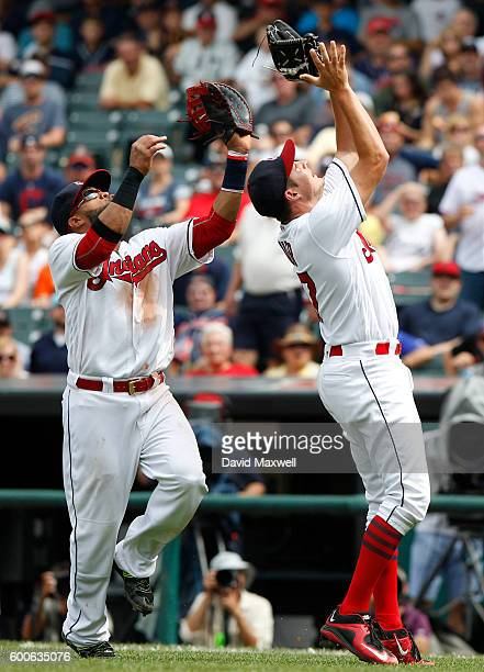 Trevor Bauer and Carlos Santana the Cleveland Indians look to catch popup by Jose Altuve of the Houston Astros in the fifth inning at Progressive...
