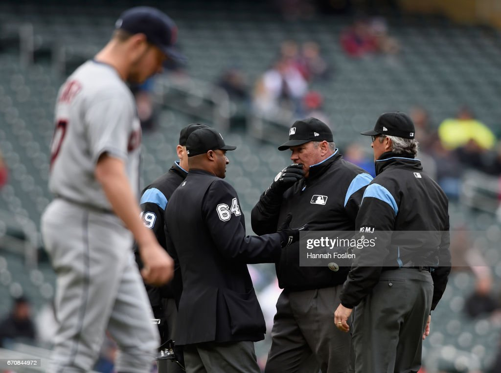 Trevor Bauer #47 of the Cleveland Indians looks on as the umpires discuss a call during the sixth inning of the game against the Minnesota Twins on April 20, 2017 at Target Field in Minneapolis, Minnesota. The Indians defeated the Twins 6-2.