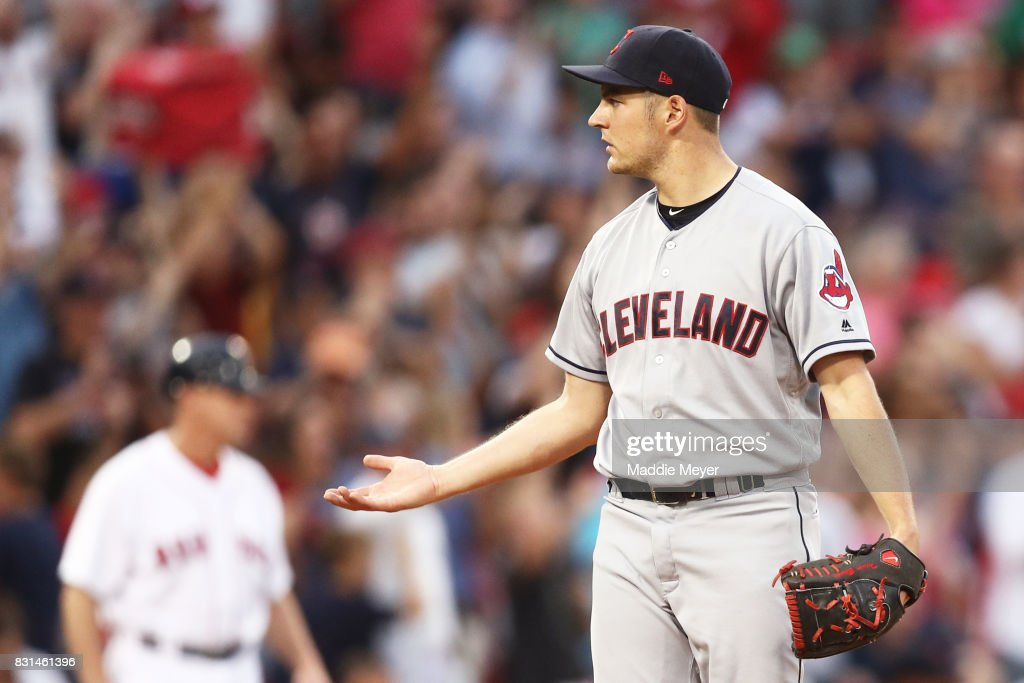 Trevor Bauer #47 of the Cleveland Indians reacts after Rafael Devers #11 of the Boston Red Sox hit a home run during the fourth inning at Fenway Park on August 14, 2017 in Boston, Massachusetts.