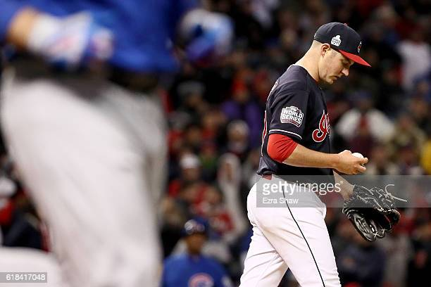 Trevor Bauer of the Cleveland Indians reacts after walking Anthony Rizzo of the Chicago Cubs during the third inning in Game Two of the 2016 World...