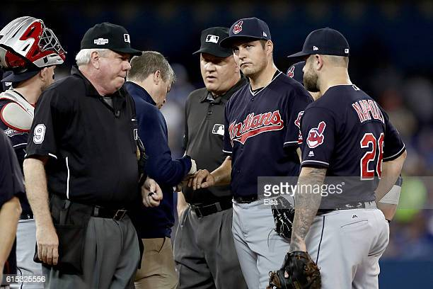 Trevor Bauer of the Cleveland Indians walks back to the dugout after being relieved due to his cut pinky finger in the first inning against the...