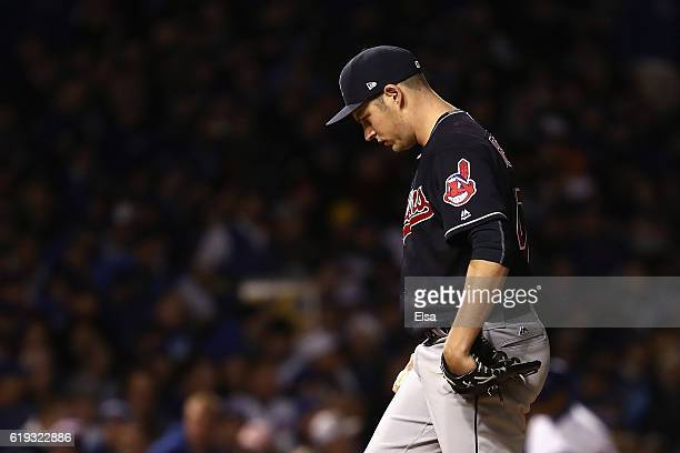 Trevor Bauer of the Cleveland Indians walks off the field after pitching in the third inning against the Chicago Cubs in Game Five of the 2016 World...