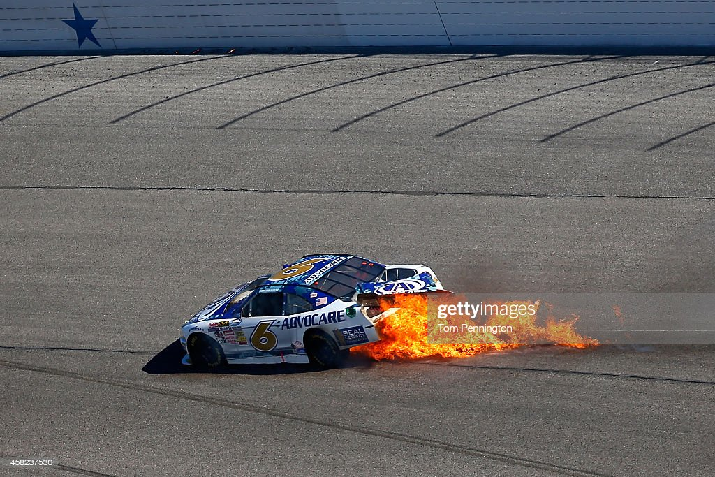 Trevor Bayne driver of the AdvoCare Ford crashes during the NASCAR Nationwide Series O'Reilly Auto Parts Challenge at Texas Motor Speedway on...