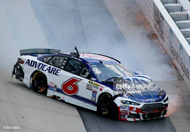 Trevor Bayne driver of the AdvoCare Ford crashes during the NASCAR Sprint Cup Series FedEx 400 Benefiting Autism Speaks at Dover International...