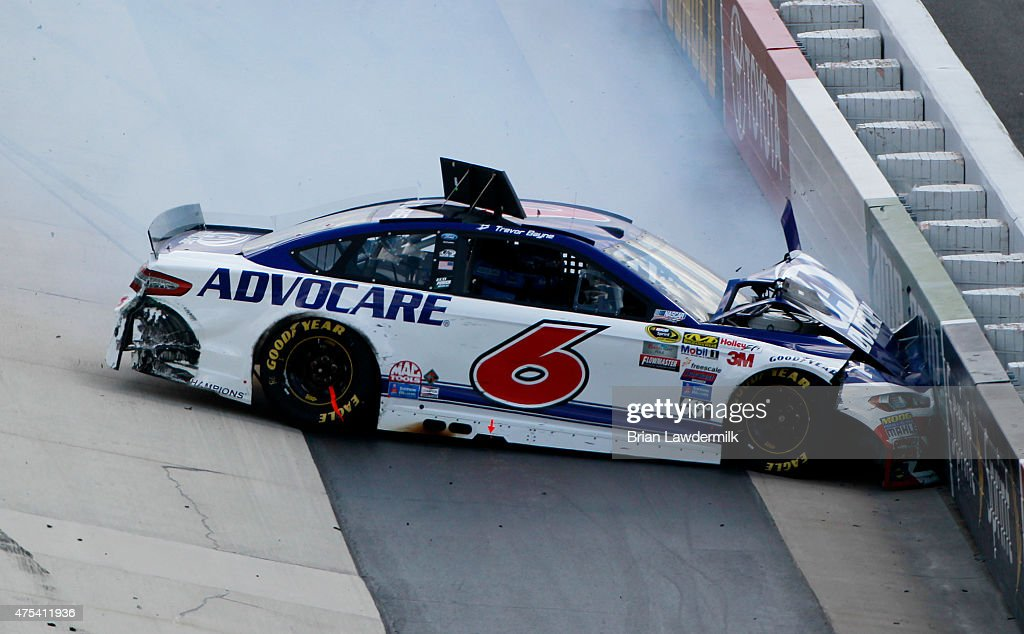 <a gi-track='captionPersonalityLinkClicked' href=/galleries/search?phrase=Trevor+Bayne&family=editorial&specificpeople=5533943 ng-click='$event.stopPropagation()'>Trevor Bayne</a>, driver of the #6 AdvoCare Ford, crashes during the NASCAR Sprint Cup Series FedEx 400 Benefiting Autism Speaks at Dover International Speedway on May 31, 2015 in Dover, Delaware.