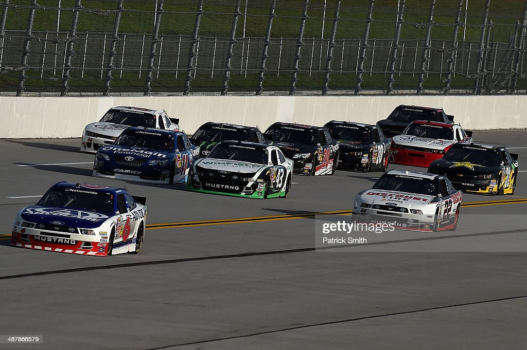 <a gi-track='captionPersonalityLinkClicked' href=/galleries/search?phrase=Trevor+Bayne&family=editorial&specificpeople=5533943 ng-click='$event.stopPropagation()'>Trevor Bayne</a>, driver of the #6 AdvoCare Ford, leads a pack of cars during qualifying for the NASCAR Nationwide Series Aaron's 312 at Talladega Superspeedway on May 2, 2014 in Talladega, Alabama.