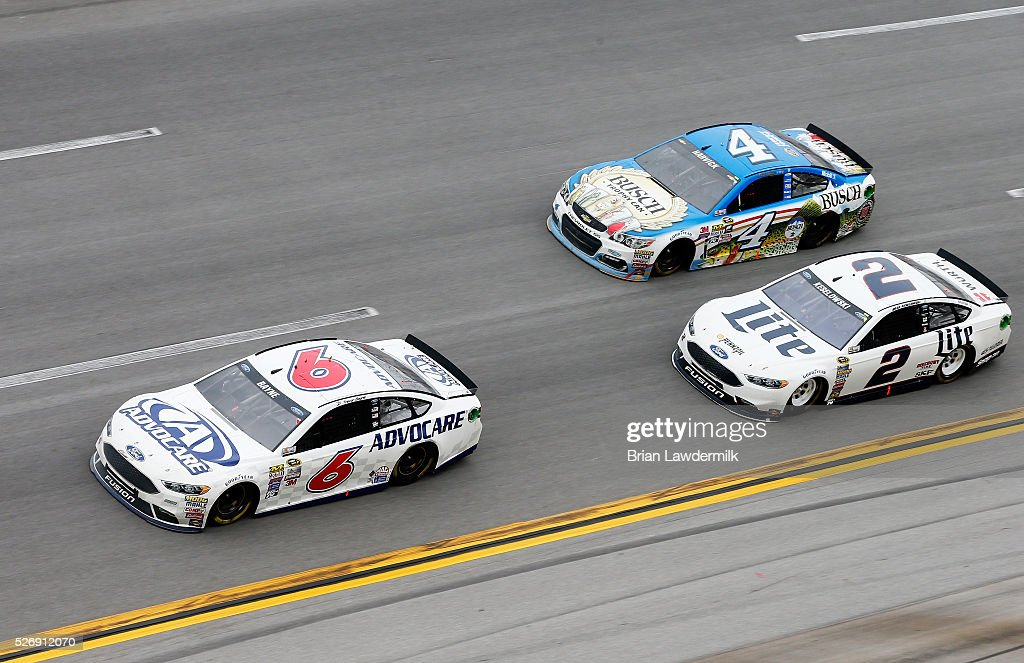 Trevor Bayne, driver of the #6 AdvoCare Ford, leads the field ahead of Kevin Harvick, driver of the #4 Busch Fishing Chevrolet, and Brad Keselowski, driver of the #2 Miller Lite Ford, during the NASCAR Sprint Cup Series GEICO 500 at Talladega Superspeedway on May 1, 2016 in Talladega, Alabama.