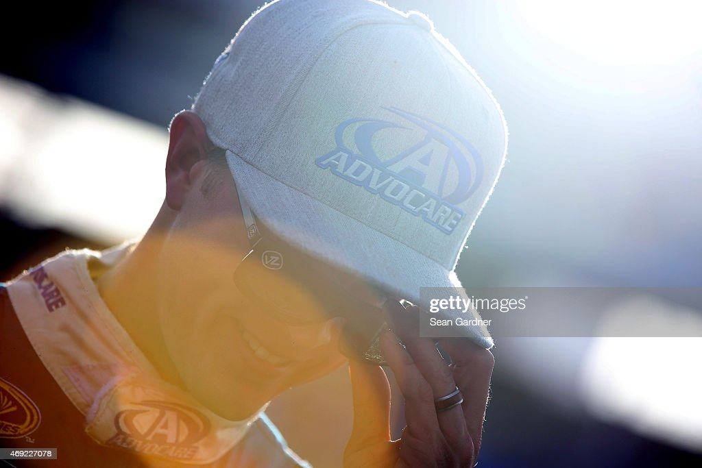 <a gi-track='captionPersonalityLinkClicked' href=/galleries/search?phrase=Trevor+Bayne&family=editorial&specificpeople=5533943 ng-click='$event.stopPropagation()'>Trevor Bayne</a>, driver of the #6 AdvoCare Ford, looks on from the grid during qualifying for the NASCAR Sprint Cup Series Duck Commander 500 at Texas Motor Speedway on April 10, 2015 in Fort Worth, Texas.