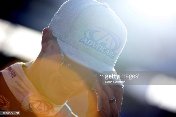 Trevor Bayne driver of the AdvoCare Ford looks on from the grid during qualifying for the NASCAR Sprint Cup Series Duck Commander 500 at Texas Motor...