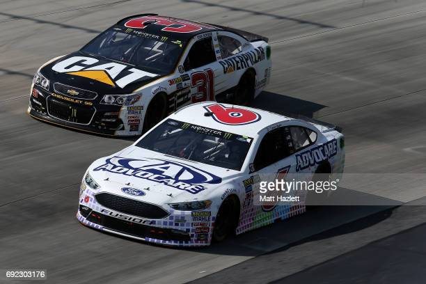 Trevor Bayne driver of the AdvoCare Ford races Ryan Newman driver of the Caterpillar Chevrolet during the Monster Energy NASCAR Cup Series AAA 400...