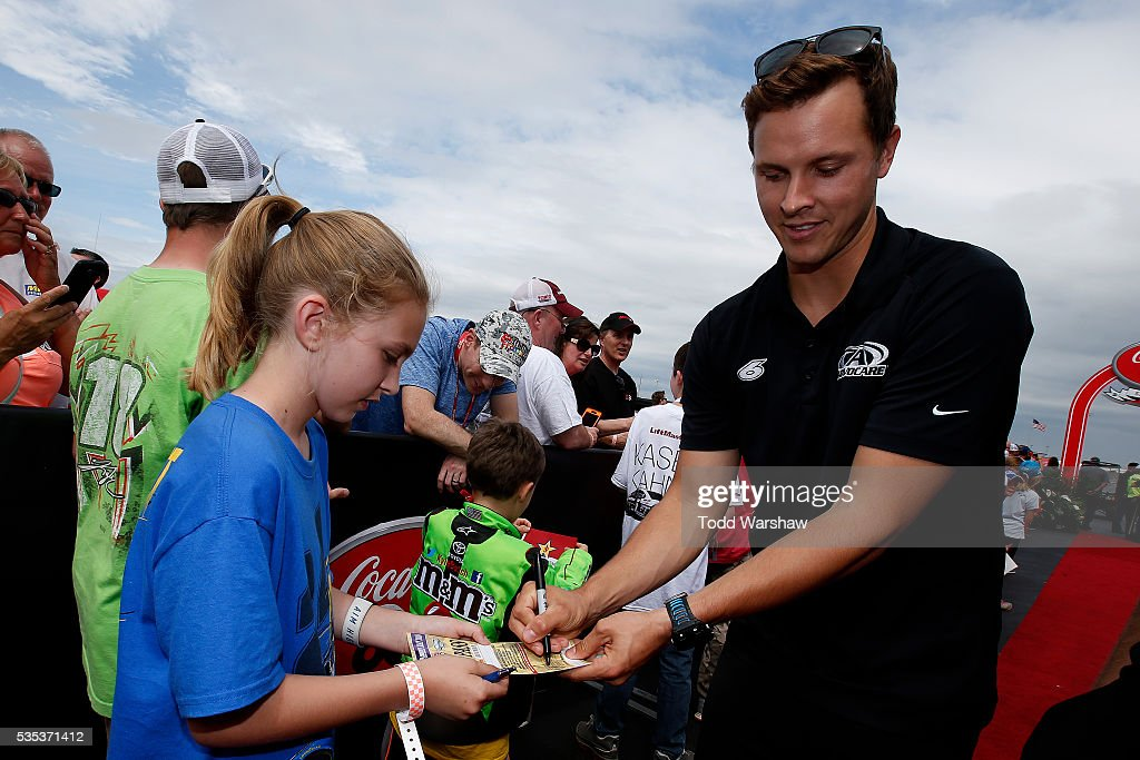 <a gi-track='captionPersonalityLinkClicked' href=/galleries/search?phrase=Trevor+Bayne&family=editorial&specificpeople=5533943 ng-click='$event.stopPropagation()'>Trevor Bayne</a>, driver of the #6 AdvoCare Ford, signs autographs for fans at the driver's meeting prior to the NASCAR Sprint Cup Series Coca-Cola 600 at Charlotte Motor Speedway on May 29, 2016 in Charlotte, North Carolina.