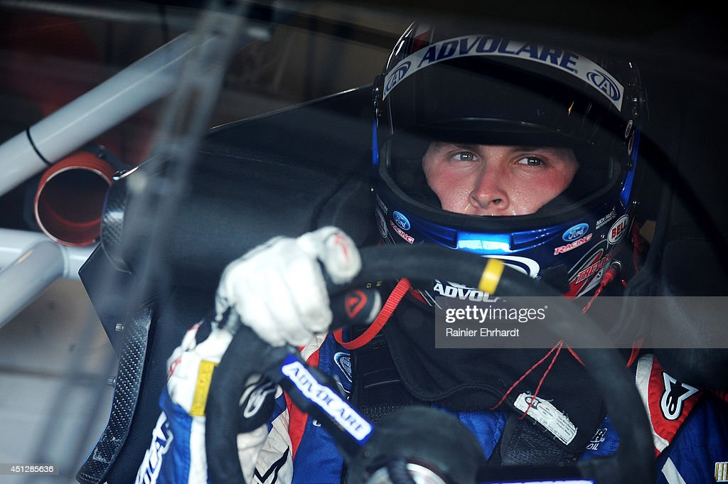 Trevor Bayne, driver of the #6 AdvoCare Ford, sits in his car in the garage area during practice for the NASCAR Nationwide Series John R. Elliott HERO Campaign presented by Drive Sober or Get Pulled Over at Kentucky Speedway on June 26, 2014 in Sparta, Kentucky.