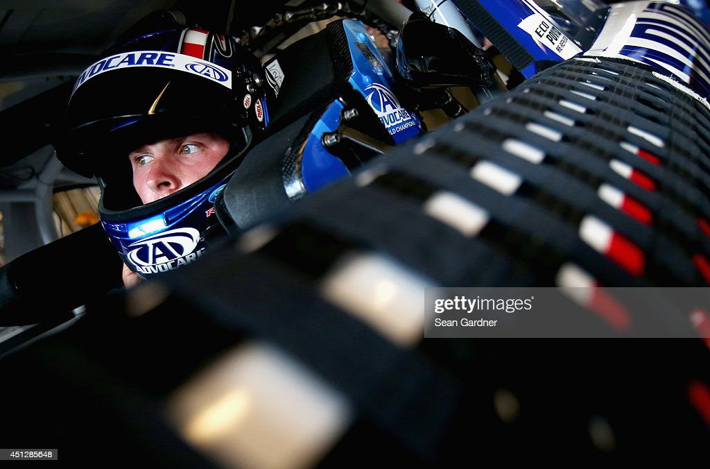 Trevor Bayne driver of the AdvoCare Ford sits in his car in the garage area during practice for the NASCAR Nationwide Series John R Elliott HERO...