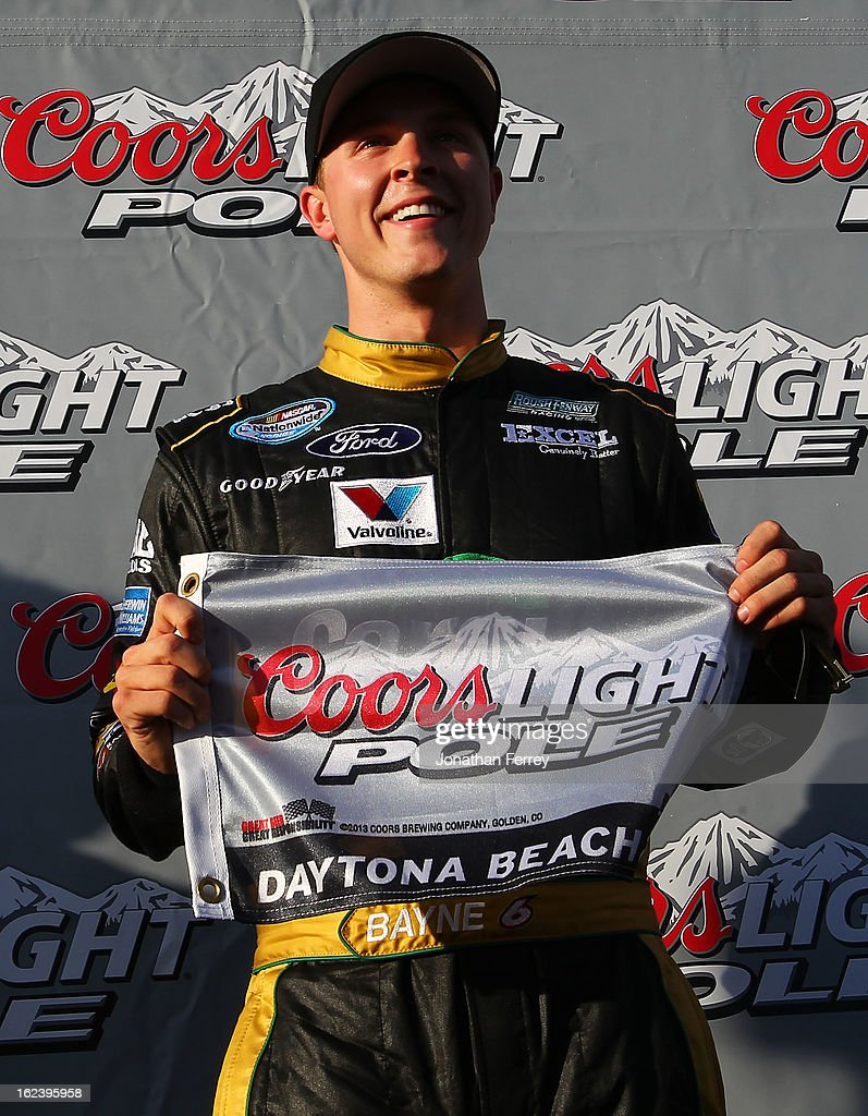<a gi-track='captionPersonalityLinkClicked' href=/galleries/search?phrase=Trevor+Bayne&family=editorial&specificpeople=5533943 ng-click='$event.stopPropagation()'>Trevor Bayne</a>, driver of the #6 Cargill Ford, poses with the Coors Light Pole flag after qualifying first for the NASCAR Nationwide Series DRIVE4COPD 300 at Daytona International Speedway on February 22, 2013 in Daytona Beach, Florida.