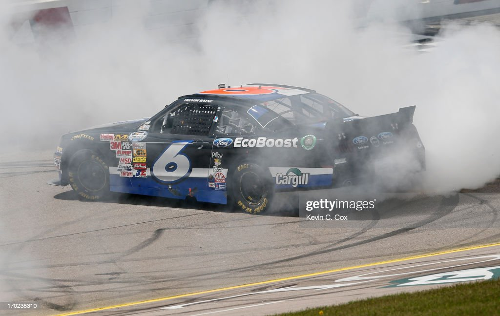 <a gi-track='captionPersonalityLinkClicked' href=/galleries/search?phrase=Trevor+Bayne&family=editorial&specificpeople=5533943 ng-click='$event.stopPropagation()'>Trevor Bayne</a>, driver of the #6 Ford EcoBoost Ford, celebrates winning the NASCAR Nationwide Series DuPont Pioneer 250 at Iowa Speedway on June 9, 2013 in Newton, Iowa.