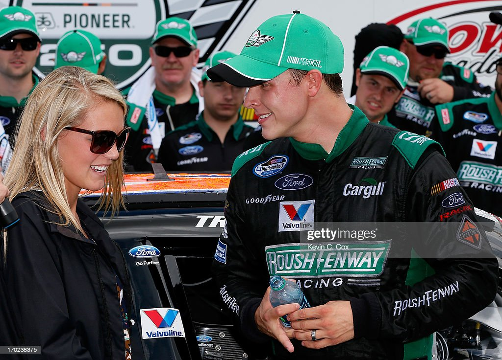 Trevor Bayne driver of the Ford EcoBoost Ford celebrates winning the NASCAR Nationwide Series DuPont Pioneer 250 with his wife Ashton at Iowa...