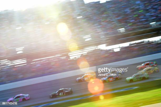 Trevor Bayne driver of the Liberty National Ford leads a pack of cars during the Monster Energy NASCAR Cup Series Alabama 500 at Talladega...