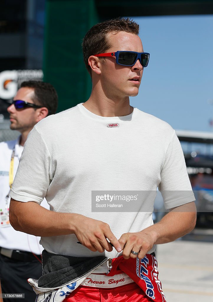 <a gi-track='captionPersonalityLinkClicked' href=/galleries/search?phrase=Trevor+Bayne&family=editorial&specificpeople=5533943 ng-click='$event.stopPropagation()'>Trevor Bayne</a>, driver of the #21 Motorcraft / Quick Lane Tire & Auto Center Ford, stands on the grid during qualifying for the NASCAR Sprint Cup Series Coke Zero 400 at Daytona International Speedway on July 5, 2013 in Daytona Beach, Florida.