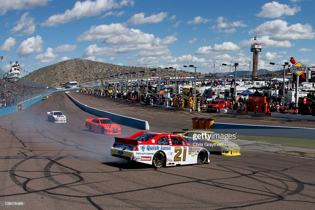 Trevor Bayne driver of the Motorcraft/Quick Lane Ford spins into turn one during the Subway Fresh Fit 500 at Phoenix International Raceway on...