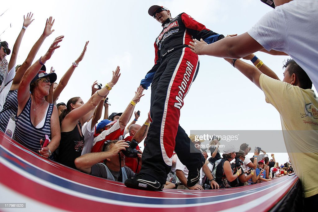 Trevor Bayne driver of the Motorcraft/Quick Lane Tire Auto Center Ford is introduced to the crowd during the NASCAR Sprint Cup Series Coke ZERO 400...