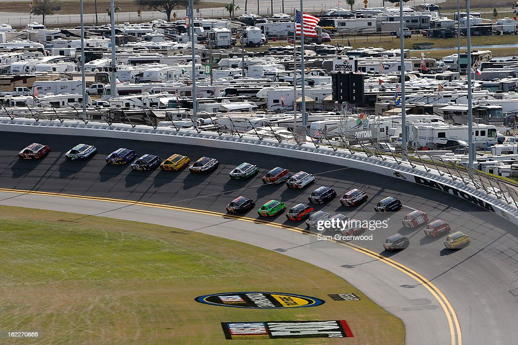 Trevor Bayne, driver of the #21 Motorcraft/Quick Lane Tire & Auto Center Ford, leads the field during the NASCAR Sprint Cup Series Budweiser Duel 1 at Daytona International Speedway on February 21, 2013 in Daytona Beach, Florida.