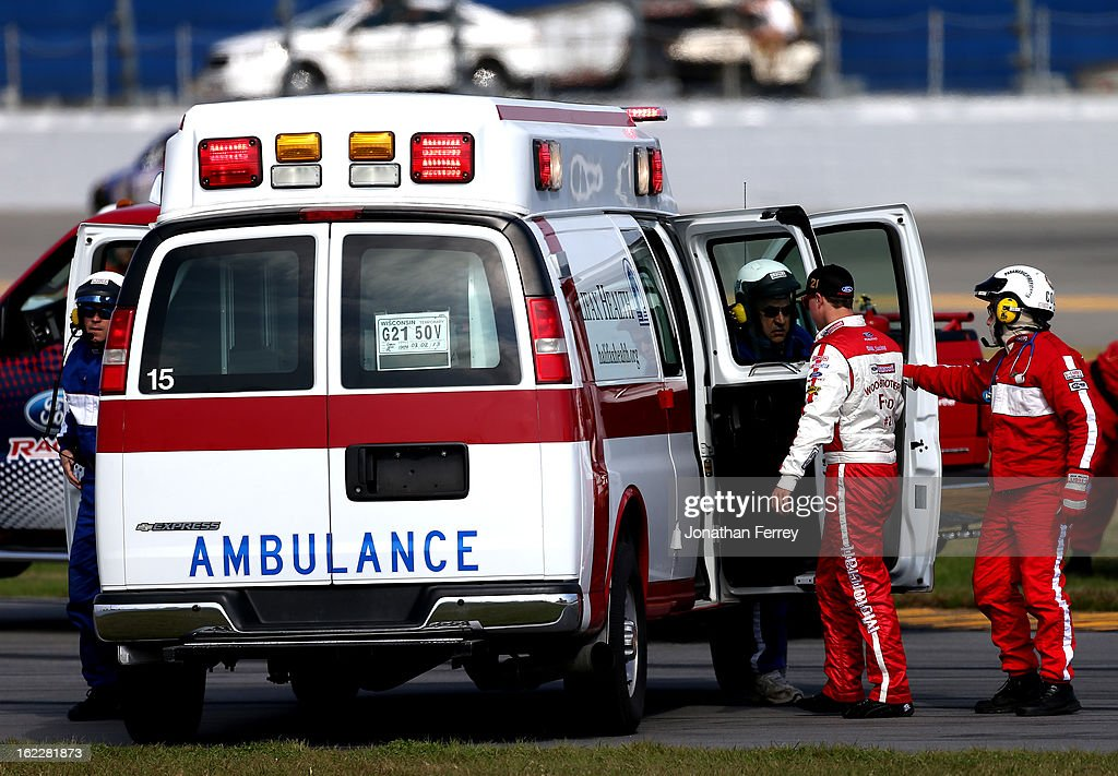 Trevor Bayne, driver of the #21 Motorcraft/Quick Lane Tire & Auto Center Ford, climbs into an Ambulance after an incident in the NASCAR Sprint Cup Series Budweiser Duel 1 at Daytona International Speedway on February 21, 2013 in Daytona Beach, Florida.