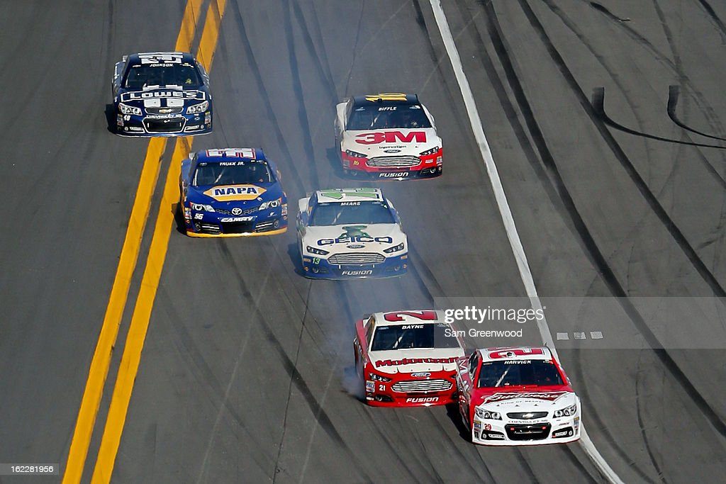 Trevor Bayne, driver of the #21 Motorcraft/Quick Lane Tire & Auto Center Ford, bumps Kevin Harvick, driver of the #29 Budweiser Chevrolet, during the NASCAR Sprint Cup Series Budweiser Duel 1 at Daytona International Speedway on February 21, 2013 in Daytona Beach, Florida.