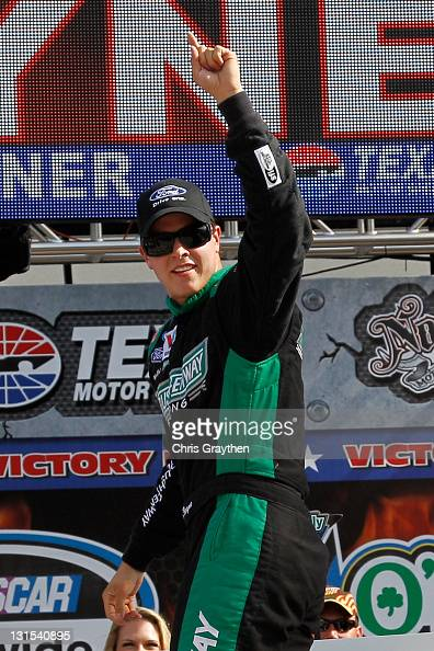 Trevor Bayne driver of the RickyVsTrevorcom Ford celebrates with his crew in victory lane after he won the NASCAR Nationwide Series O'Reilly Auto...